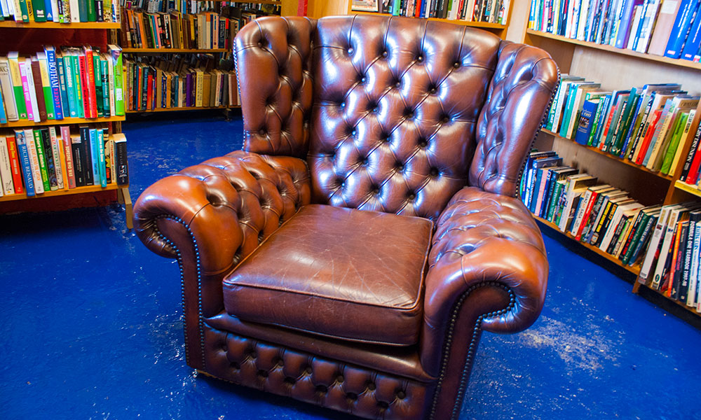 One of Astley Book Farm's comfy leather armchairs